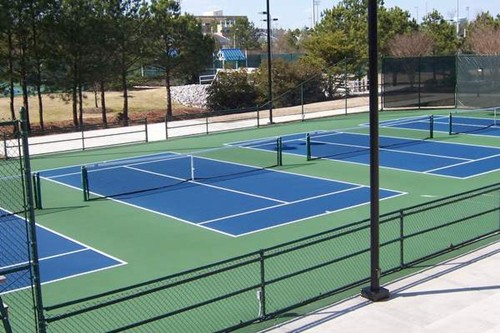 Four stand alone 36' tennis courts in a stadium. These courts were converted from one 78' tennis cou