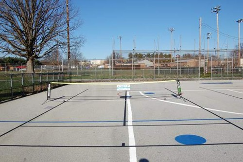 Two 36' tennis courts on a multi-purpose school blacktop surface.
